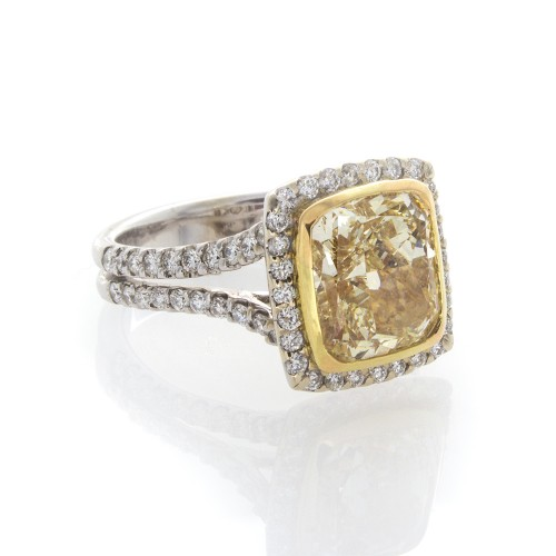 FANCY YELLOW CUSHION CUT 4.07 CT